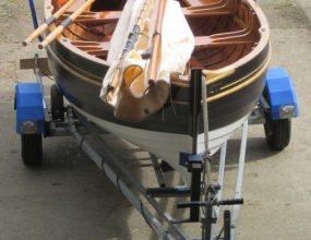 12ft Wil Stirling Classic sailing dinghy, Combination road trailer and electric outboard engine.
