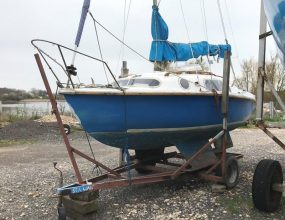 Leisure 17 Bilge keel sloop with yard trailer.